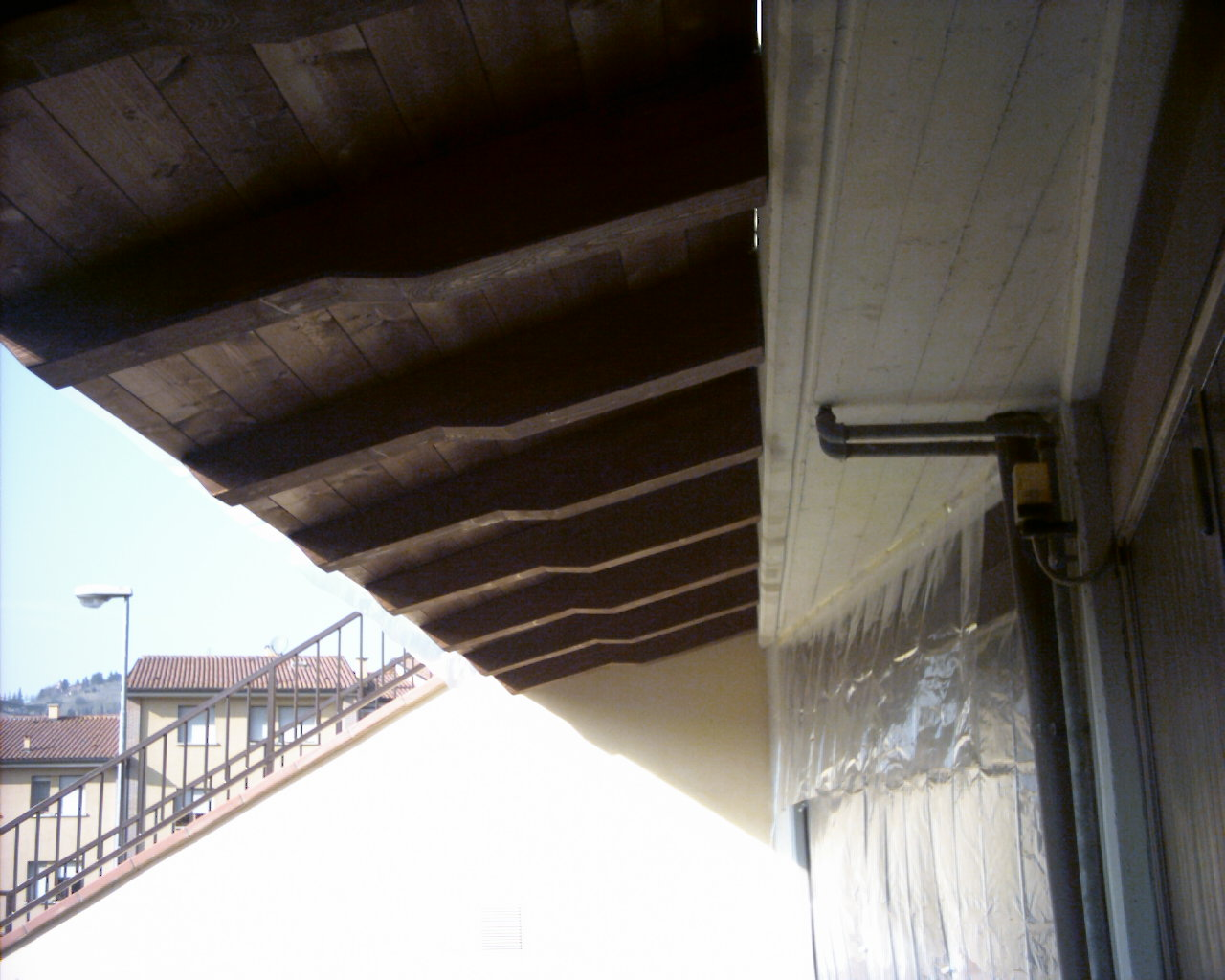 Copri porta e finestra con travetti monobraccio